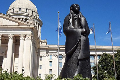 Oklahoma State Capitol building with statue of Native American woman